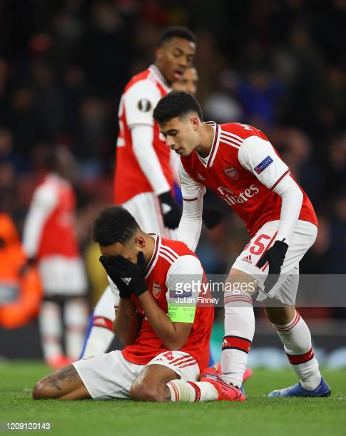 PierreEmerick Aubameyang of Arsenal FC is consoled by Gabriel Martinelli of Arsenal FC after a missed chance during the UEFA Europa League round of...