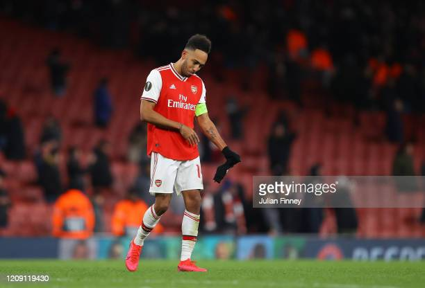 PierreEmerick Aubameyang of Arsenal FC looks dejected after defeat in the UEFA Europa League round of 32 second leg match between Arsenal FC and...