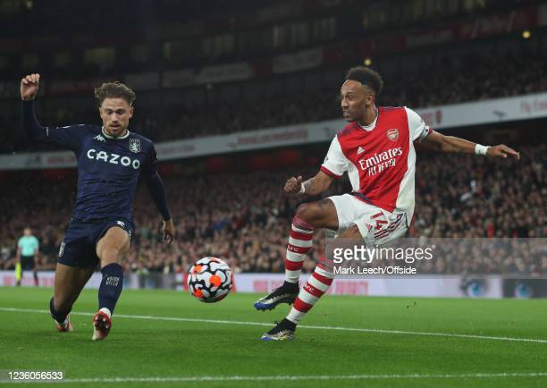 Pierre-Emerick Aubameyang of Arsenal has his cross blocked by Matty Cash of Aston Villa during the Premier League match between Arsenal and Aston...