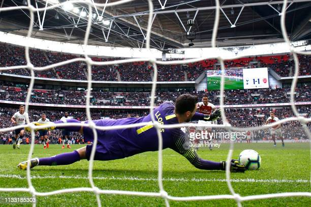 PierreEmerick Aubameyang of Arsenal has his penalty saved by Hugo Lloris of Tottenham Hotspur during the Premier League match between Tottenham...