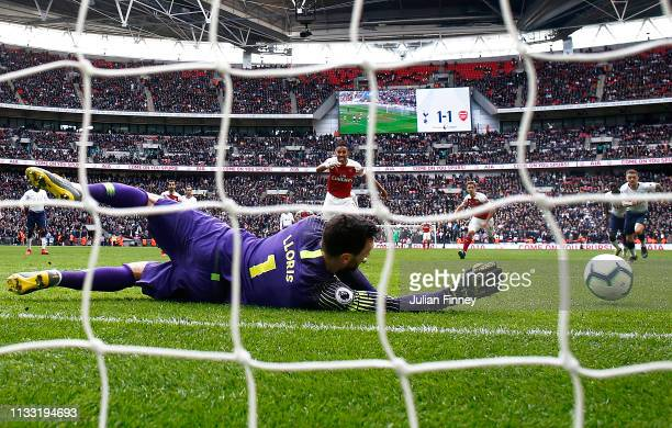 PierreEmerick Aubameyang of Arsenal has his penalty saved by Hugo Lloris of Tottenham during the Premier League match between Tottenham Hotspur and...