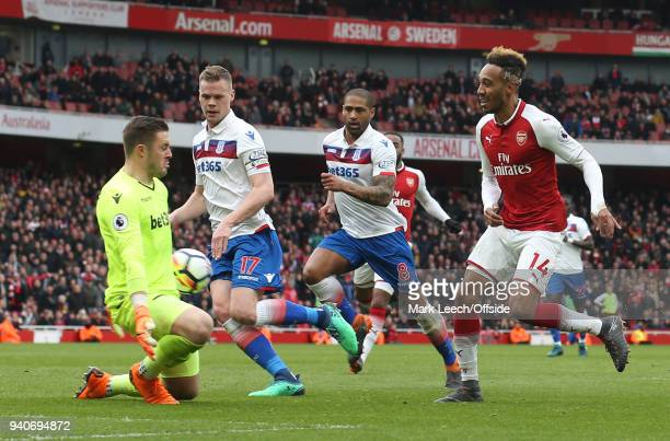 PierreEmerick Aubameyang of Arsenal has his shot saved by Stoke goalkeeper Jack Butland during the Premier League match between Arsenal and Stoke...