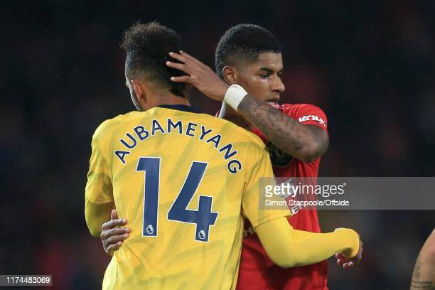 Pierre-Emerick Aubameyang of Arsenal hugs Marcus Rashford of Man Utd after the Premier League match between Manchester United and Arsenal FC at Old...