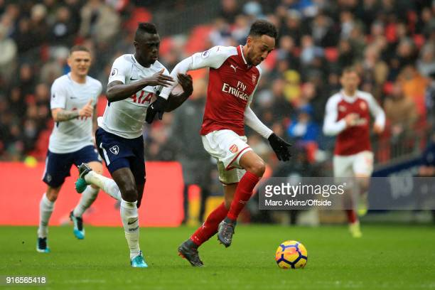 PierreEmerick Aubameyang of Arsenal in action with Davinson Sanchez of Tottenham Hotspur during the Premier League match between Tottenham Hotspur...