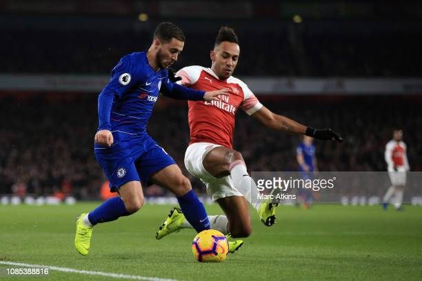 PierreEmerick Aubameyang of Arsenal in action with Eden Hazard of Chelsea during the Premier League match between Arsenal FC and Chelsea FC at...