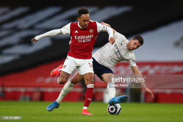 Pierre-Emerick Aubameyang of Arsenal in action with Ruben Dias of Manchester City during the Premier League match between Arsenal and Manchester City...