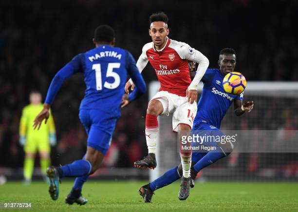 PierreEmerick Aubameyang of Arsenal is challenged by Idrissa Gueye of Everton during the Premier League match between Arsenal and Everton at Emirates...