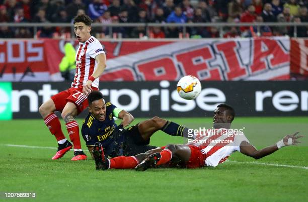 Pierre-Emerick Aubameyang of Arsenal is challenged by Ousseynou Ba of Olympiacos FC during the UEFA Europa League round of 32 first leg match between...
