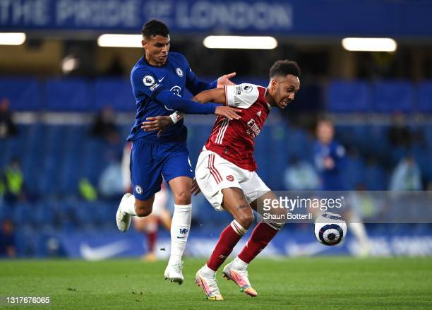 Pierre-Emerick Aubameyang of Arsenal is challenged by Thiago Silva of Chelsea during the Premier League match between Chelsea and Arsenal at Stamford...