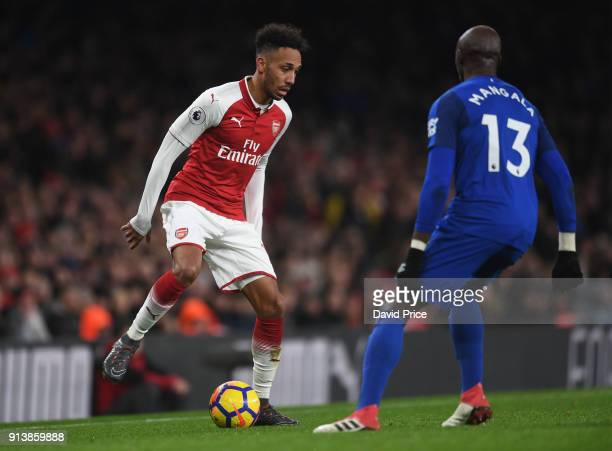 PierreEmerick Aubameyang of Arsenal is closed down by Eliaquim Mangala of Everton during the match the Premier League match between Arsenal and...