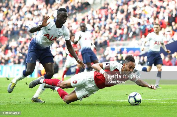 PierreEmerick Aubameyang of Arsenal is fouled by Davinson Sanchez of Tottenham Hotspur leading to a penalty during the Premier League match between...