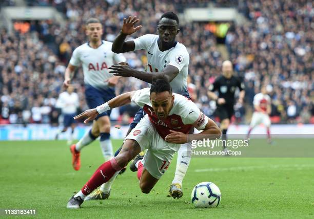 PierreEmerick Aubameyang of Arsenal is fouled by Davinson Sanzhez of Tottenham Hotspur leading to a penalty being awarded during the Premier League...