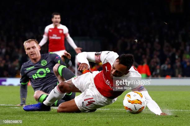Pierre-Emerick Aubameyang of Arsenal is fouled by Jeremy Mathieu of Sporting CP who is sent off during the UEFA Europa League Group E match between...