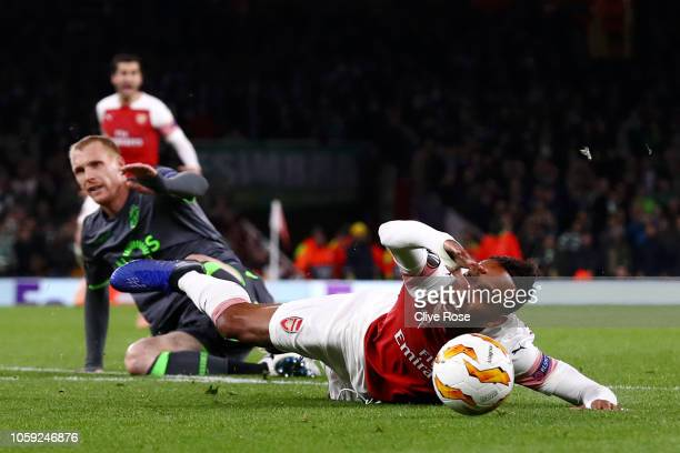 PierreEmerick Aubameyang of Arsenal is fouled by Jeremy Mathieu of Sporting CP who is sent off during the UEFA Europa League Group E match between...