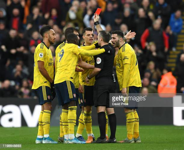 PierreEmerick Aubameyang of Arsenal is shown the red card by referee Paul Tierney during the Premier League match between Crystal Palace and Arsenal...