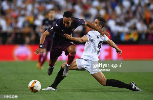 PierreEmerick Aubameyang of Arsenal is tackled by Gabriel Paulista of Valencia during the UEFA Europa League Semi Final Second Leg match between...