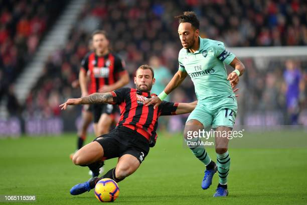 PierreEmerick Aubameyang of Arsenal is tackled by Steve Cook of AFC Bournemouth during the Premier League match between AFC Bournemouth and Arsenal...