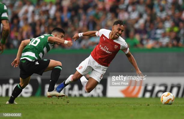 PierreEmerick Aubameyang of Arsenal is tripped by Rodrigo Battaglia of Sporting of Sporting during the UEFA Europa League Group E match between...