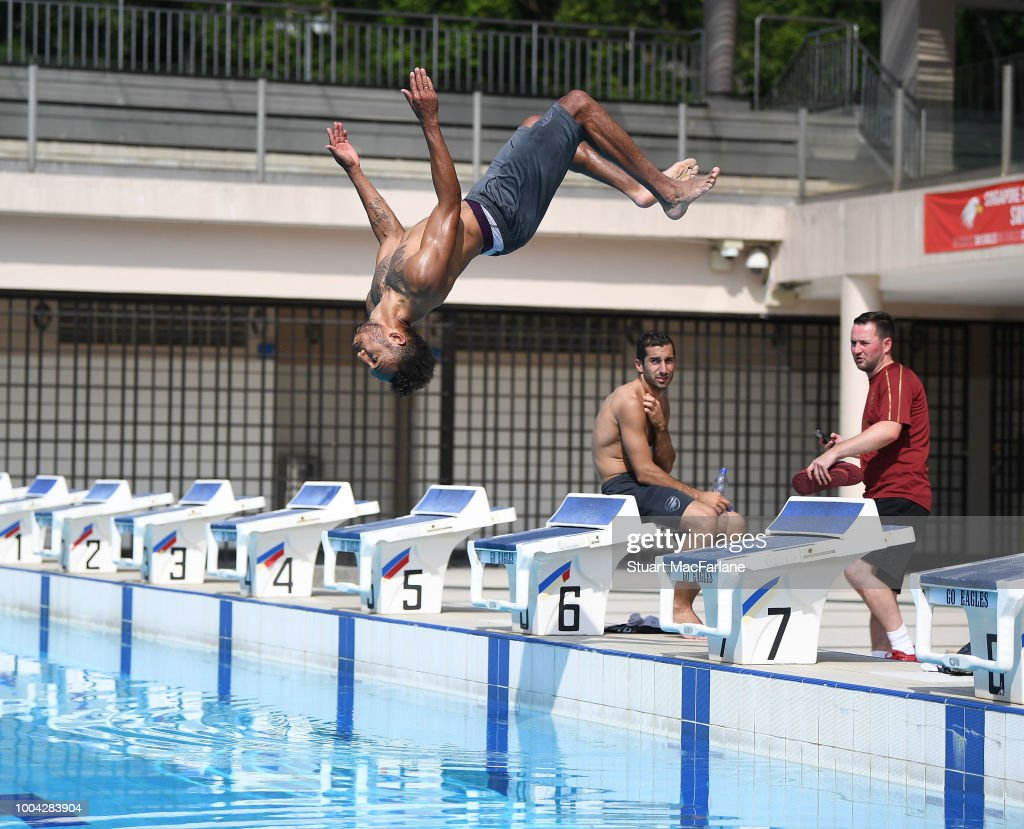 Pierre-Emerick Aubameyang of Arsenal jumps into the pool after a training session at Singapore American School on July 23, 2018 in Singapore.