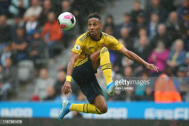 PierreEmerick Aubameyang of Arsenal jumps to control the ball during the Premier League match between Newcastle United and Arsenal FC at St James...