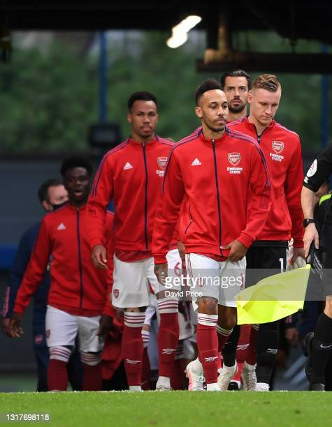 Pierre-Emerick Aubameyang of Arsenal leads out the team before the Premier League match between Chelsea and Arsenal at Stamford Bridge on May 12,...
