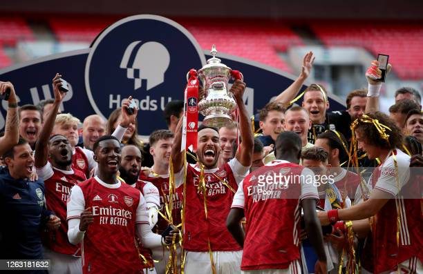 PierreEmerick Aubameyang of Arsenal lifts the FA Cup Trophy with his team mates after their victory in the Heads Up FA Cup Final match between...