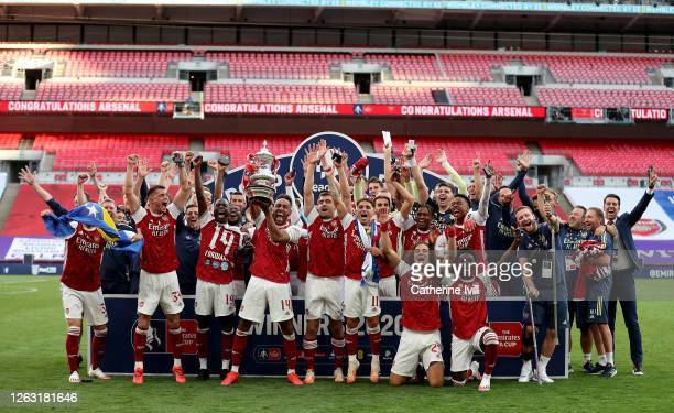 Pierre-Emerick Aubameyang of Arsenal lifts the FA Cup Trophy with his team mates after their victory in the Heads Up FA Cup Final match between...