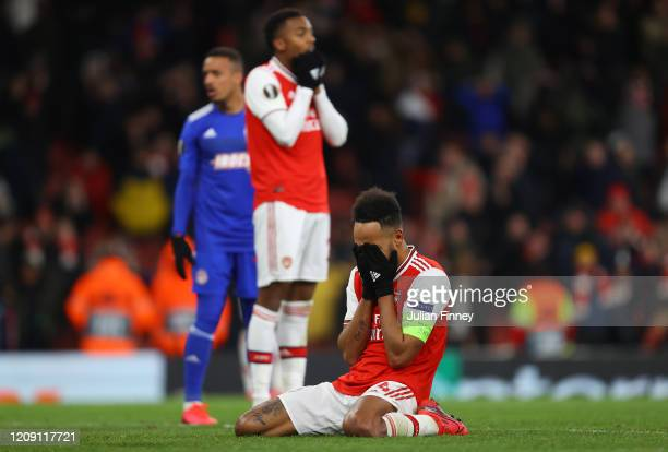 PierreEmerick Aubameyang of Arsenal looks dejected after his missed chance towards the end of time during the UEFA Europa League round of 32 second...