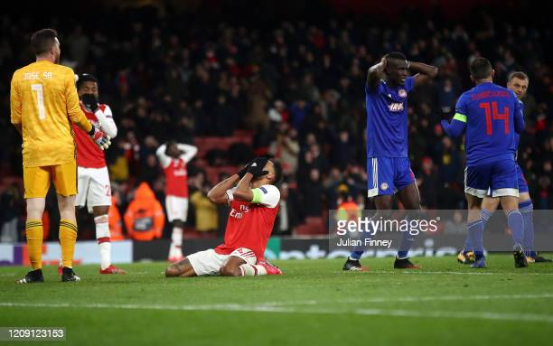 Pierre-Emerick Aubameyang of Arsenal looks dejected after his missed chance towards the end of time during the UEFA Europa League round of 32 second...