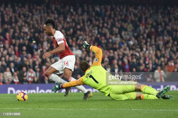 PierreEmerick Aubameyang of Arsenal on his way to scoring his team's fourth goal during the Premier League match between Arsenal FC and AFC...