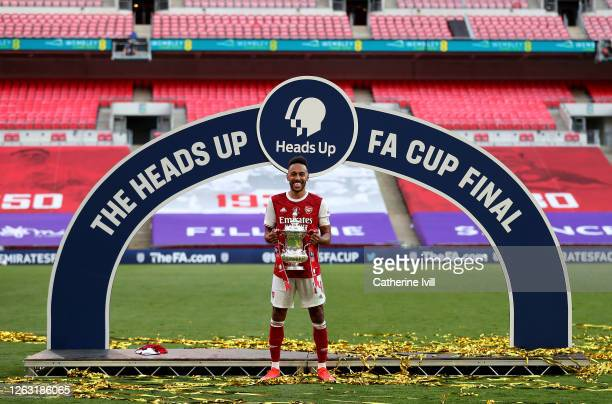 Pierre-Emerick Aubameyang of Arsenal poses with the FA Cup Trophy after his teams victory in the Heads Up FA Cup Final match between Arsenal and...