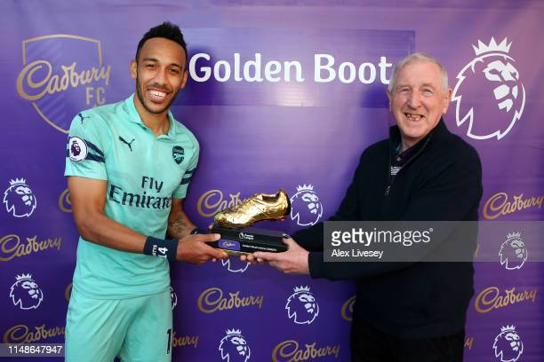 PierreEmerick Aubameyang of Arsenal poses with the golden boot trophy after the Premier League match between Burnley FC and Arsenal FC at Turf Moor...