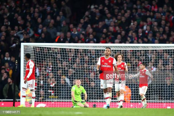PierreEmerick Aubameyang of Arsenal reacts after Chelsea score their first goal during the Premier League match between Arsenal FC and Chelsea FC at...