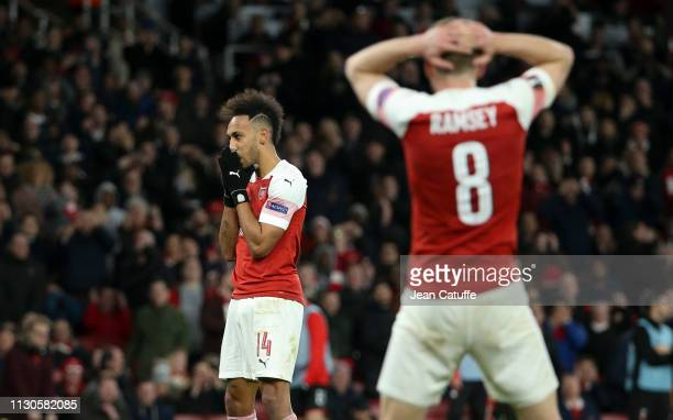 PierreEmerick Aubameyang of Arsenal reacts after missing a goal while Aaron Ramsey looks on during the UEFA Europa League Round of 16 Second Leg...
