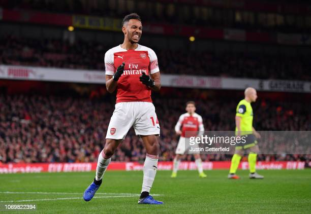 PierreEmerick Aubameyang of Arsenal reacts during the Premier League match between Arsenal FC and Huddersfield Town at Emirates Stadium on December 8...