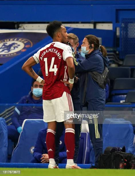 Pierre-Emerick Aubameyang of Arsenal receives medical attention during the Premier League match between Chelsea and Arsenal at Stamford Bridge on May...