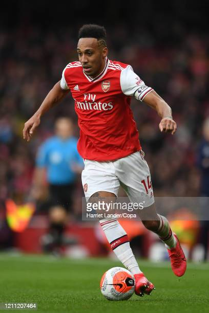 PierreEmerick Aubameyang of Arsenal runs with the ball during the Premier League match between Arsenal FC and West Ham United at Emirates Stadium on...