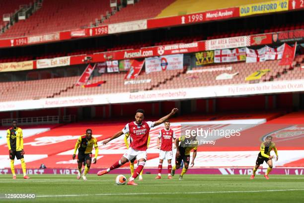 Pierre-Emerick Aubameyang of Arsenal scores a penalty during the Premier League match between Arsenal FC and Watford FC at Emirates Stadium on July...