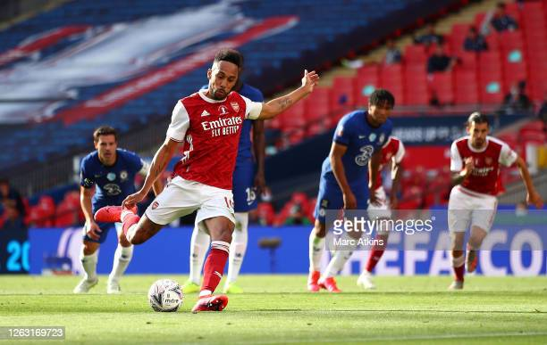 Pierre-Emerick Aubameyang of Arsenal scores a penalty for his team's first goal during the FA Cup Final match between Arsenal and Chelsea at Wembley...