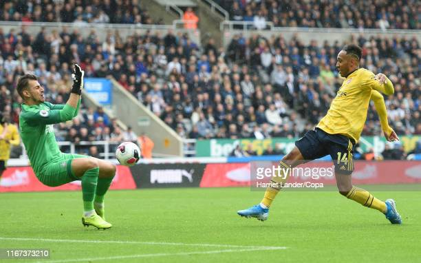 PierreEmerick Aubameyang of Arsenal scores her team's first goal during the Premier League match between Newcastle United and Arsenal FC at St James...