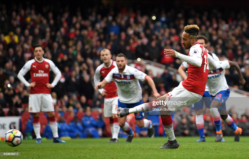 Pierre-Emerick Aubameyang of Arsenal scores his sides first goal from the penalty spot during the Premier League match between Arsenal and Stoke City at Emirates Stadium on April 1, 2018 in London, England.