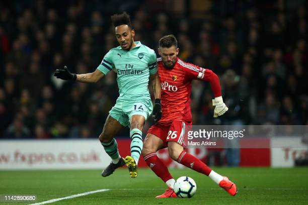 PierreEmerick Aubameyang of Arsenal scores his side's first goal past Ben Foster of Watford during the Premier League match between Watford FC and...