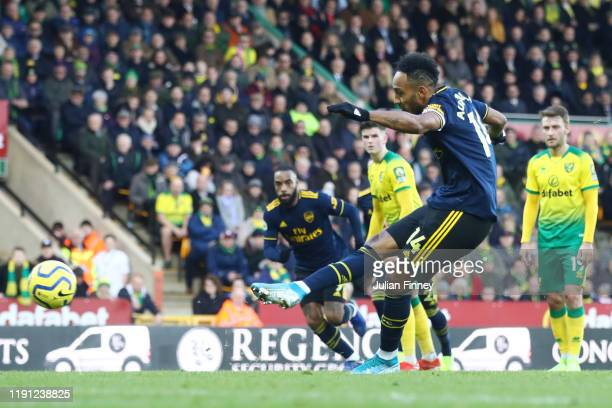 PierreEmerick Aubameyang of Arsenal scores his sides first goal during the Premier League match between Norwich City and Arsenal FC at Carrow Road on...