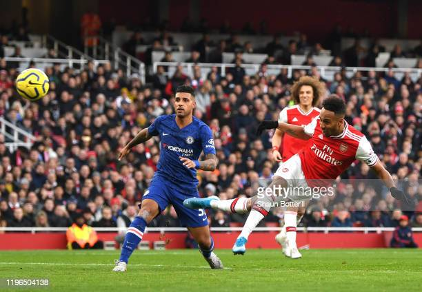 PierreEmerick Aubameyang of Arsenal scores his sides first goal during the Premier League match between Arsenal FC and Chelsea FC at Emirates Stadium...