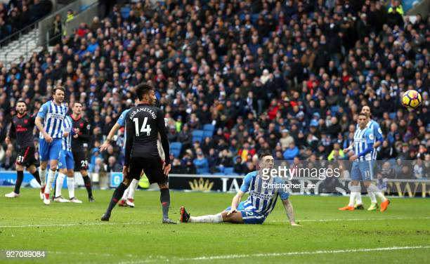 Pierre-Emerick Aubameyang of Arsenal scores his sides first goal during the Premier League match between Brighton and Hove Albion and Arsenal at Amex...