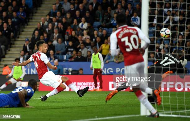 PierreEmerick Aubameyang of Arsenal scores his sides first goal during the Premier League match between Leicester City and Arsenal at The King Power...