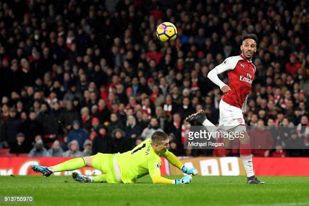 PierreEmerick Aubameyang of Arsenal scores his sides fourth goal during the Premier League match between Arsenal and Everton at Emirates Stadium on...