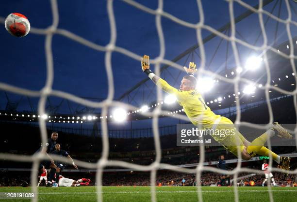 PierreEmerick Aubameyang of Arsenal scores his sides third goal past Jordan Pickford of Everton during the Premier League match between Arsenal FC...