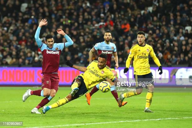Pierre-Emerick Aubameyang of Arsenal scores his sides third goal during the Premier League match between West Ham United and Arsenal FC at London...