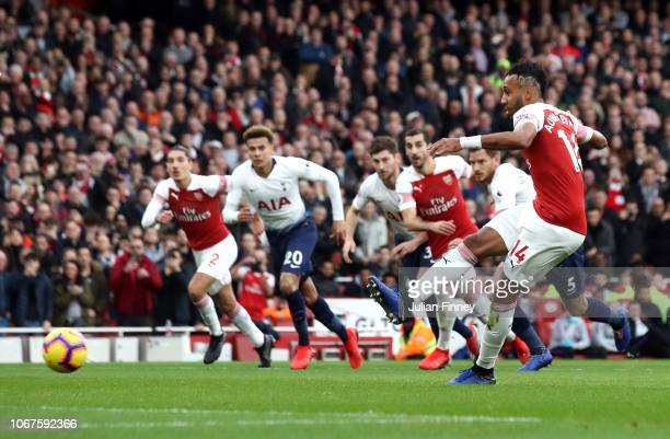 PierreEmerick Aubameyang of Arsenal scores his team's first goal during the Premier League match between Arsenal FC and Tottenham Hotspur at Emirates...